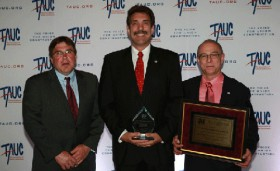John Balik (center) received the prestigious J. J. Willis Craftperson of the Year Award at TAUC's annual Leadership Conference on May 9.